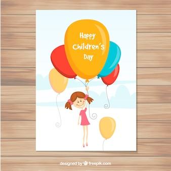 Tarjeta del día de los niños con globos coloridos