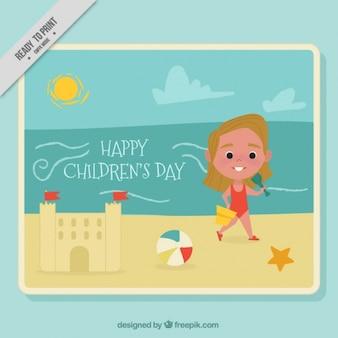 Tarjeta del día del niño con niña en la playa