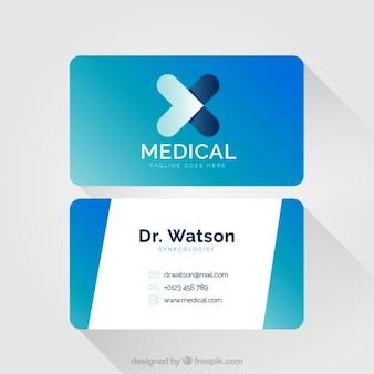 Tarjeta médica azul con un símbolo de cruz abstracta