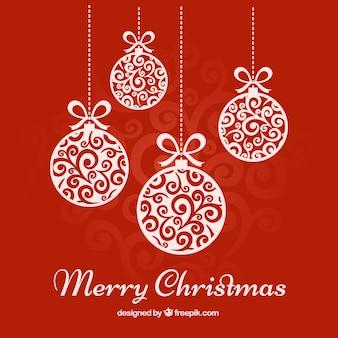 Tarjeta roja de bolas de navidad