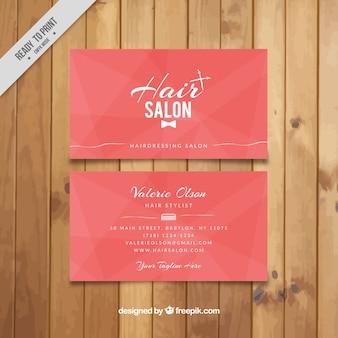 Tarjeta rosa de salón de peluquería
