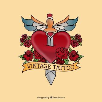 Tatuaje vintage con una daga en el corazón