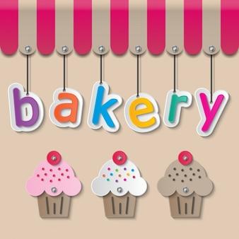 Toldos donde cuelga la palabra  bakery  y magdalenas debajo