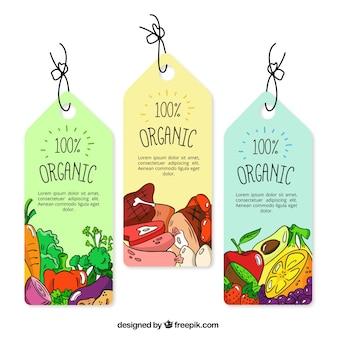 Tres etiquetas de colores con comida orgánica