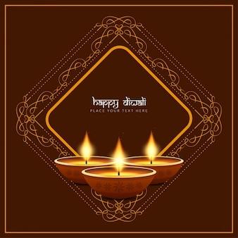 Tres velas para diwali sobre un fondo marrón con ornamentos