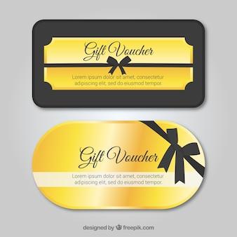 Vales de regalo dorados con cinta negra