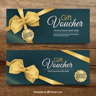 Vales de regalo elegantes con lazos dorados decorativos