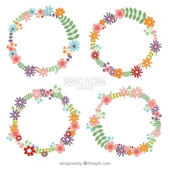Varias coronas florales de primavera en diseño plano