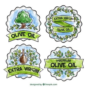 Varias pegatinas geométricas de aceite de oliva en estilo de acuarela