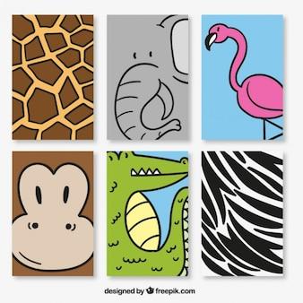 Varias tarjetas de simpáticos animales salvajes dibujados a mano