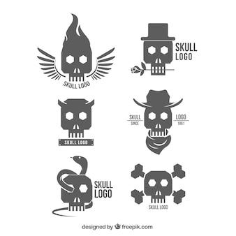 Variedad de logos de calaveras en diseño plano