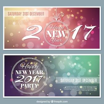 Varios banners de año nuevo con efecto bokeh
