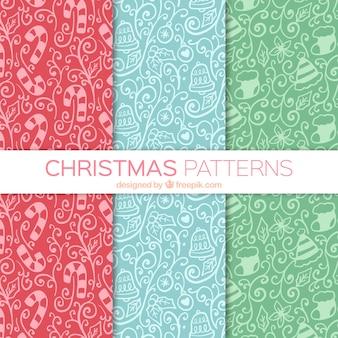 Varios patrones ornamentales dibujados a mano con elementos navideños