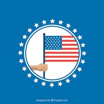 Blauer Hintergrund mit Kreis und Hand mit amerikanischen Flagge
