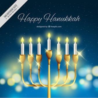 Bokeh Hanukkah Hintergrund mit glänzenden Kerzenleuchter
