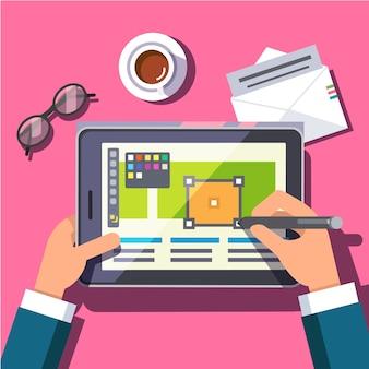 Designer arbeitet auf einem Tablet-Computer
