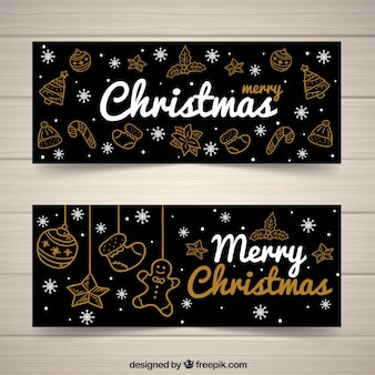 Elegante Weihnachtsfahnen mit goldenen Skizzen