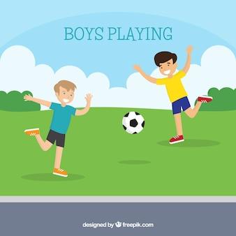 Flache Hintergrund des glücklichen Jungen spielen Fußball