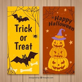 Glückliche Halloween-Banner mit Kürbissen und Fledermäusen