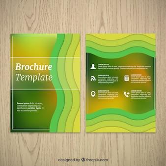 Grüne Broschüre mit welligen Formen