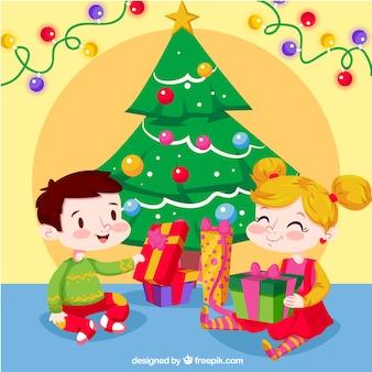 Hintergrund der glücklichen Kinder, die Weihnachtsgeschenke öffnen