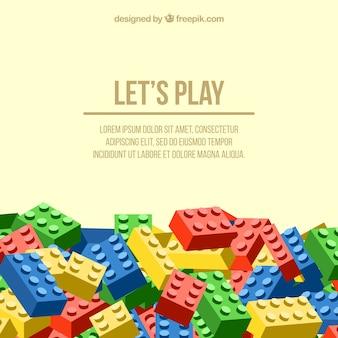 """Hintergrund """"lass uns spielen"""" mit farbigen Stücken"""
