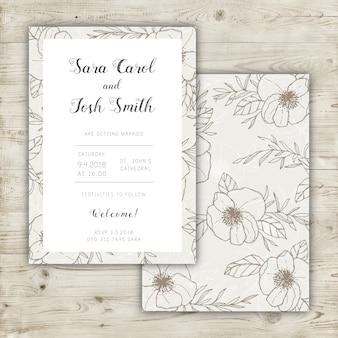 Hochzeitseinladungsentwurf mit elegantem Blumenmuster