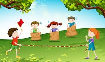 Kinder spielen Sprung Sack in der Park-Illustration