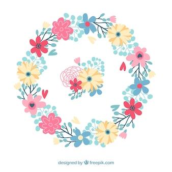 Kranz aus Blumen mit handgezeichneten Blättern