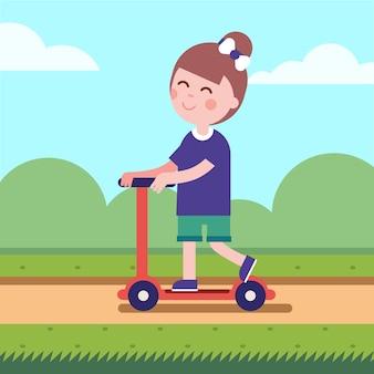 Mädchen reitet ihren Kick Roller auf einer Parkstraße