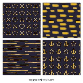 Packung mit abstrakten goldenen Mustern