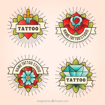 Packung von vier Vintage-Tattoo-Logos im linearen Stil