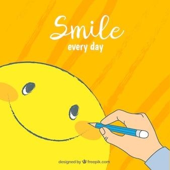 Positiver Hintergrund mit der Person, die einen Smiley zeichnet