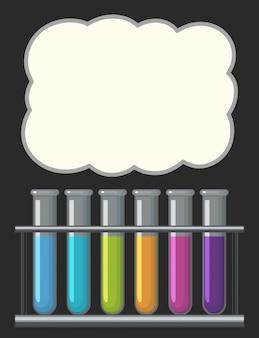 Rahmenschablone mit mit Flüssigkeit gefüllten Reagenzgläsern