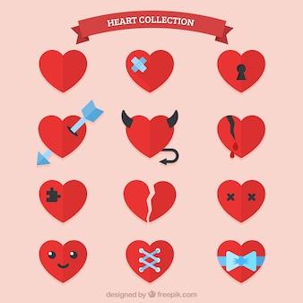 Sammlung von flachen roten Herzen mit Elementen
