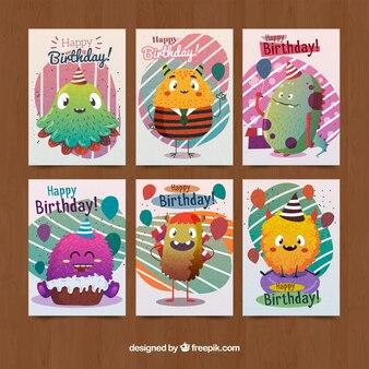 Sammlung von Geburtstagskarten mit süßen Monstern