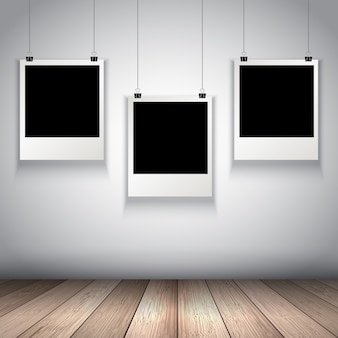 Sammlung von hängenden leeren Fotos