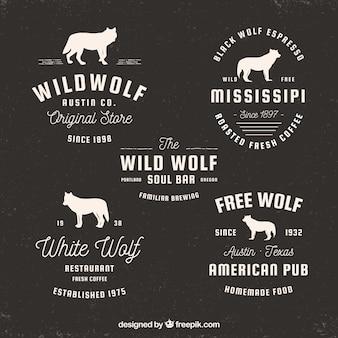 Satz von Retro-Logos mit Wolf Silhouetten