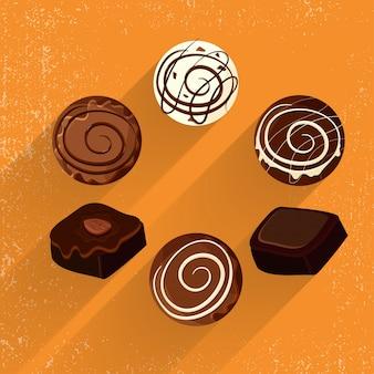 Schokolade und Kekse auf gelbem Hintergrund.