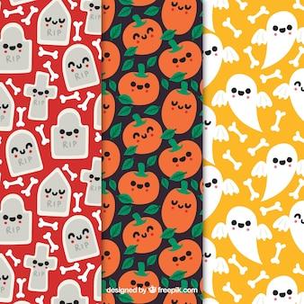 Set von süßen Halloween-Mustern mit niedlichen Zeichen