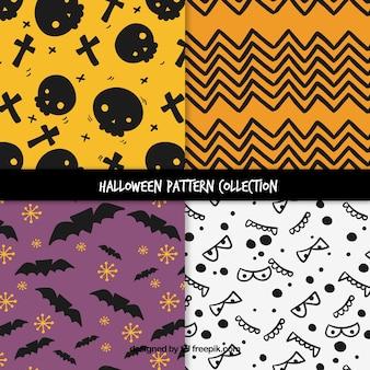 Set von vier Halloween-Mustern mit Fledermäusen und Zeichnungen