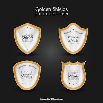 Set von weißen und goldenen Schilde