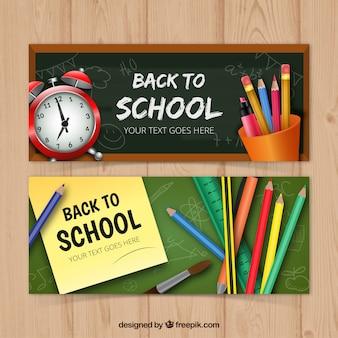 Set von zwei Banner mit realistischen Schulmaterialien