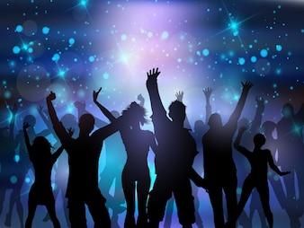 Silhouetten von Menschen tanzen auf einem abstrakten Lichter Hintergrund