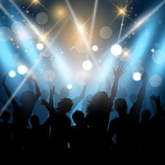 Silhouetten von Party-People auf einem Scheinwerfer Hintergrund