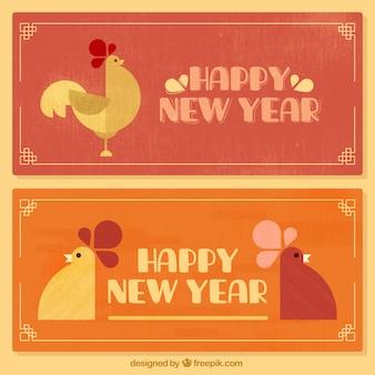 Vintage-Banner mit den Hähnen für chinesisches neues Jahr