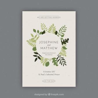 Vintage Hochzeitseinladung mit Vegetation in den grünen Tönen