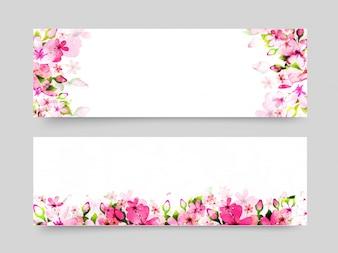 Website-Header mit rosa Aquarell-Blumen.