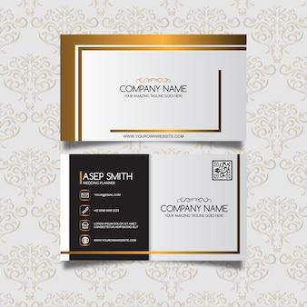 Weiße Visitenkarte mit goldenen Details