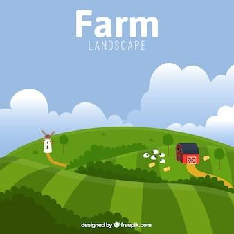 A paisagem bonita da exploração agrícola com celeiro e ovinos